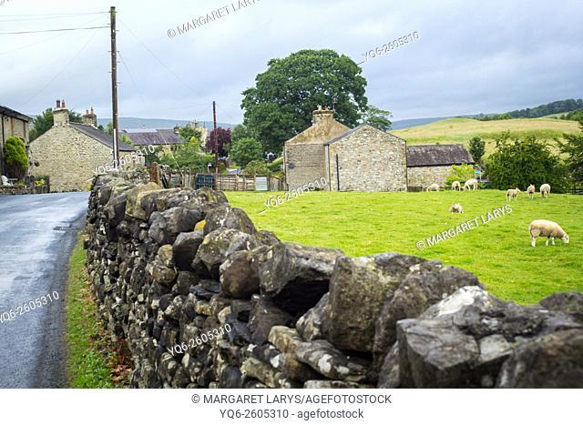 A farm and ancient stone wall, Yorkshire Dales, England, United Kingdom