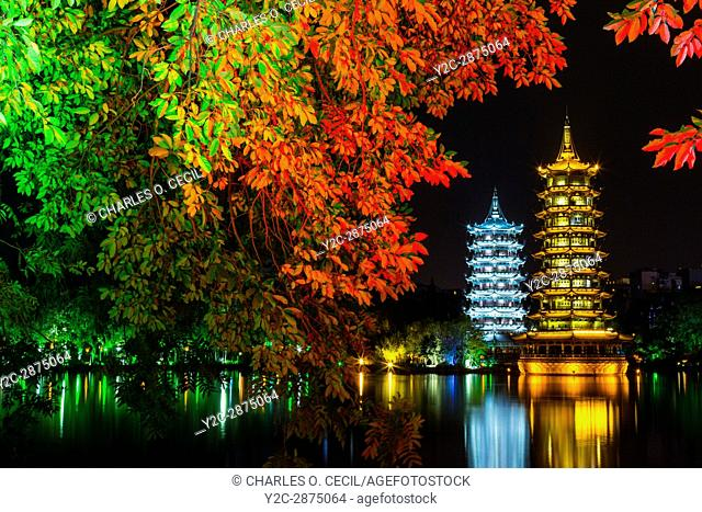 Guilin, China. Sun and Moon Pagodas beside Shan Lake at Night