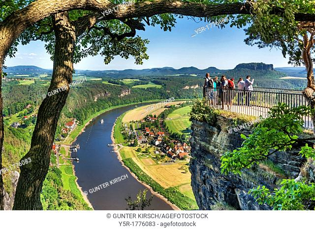 View from the spectacular rock formation Bastei Bastion to health resort Rathen and the Elbe River The Bastei is one of the most visited tourist attractions in...