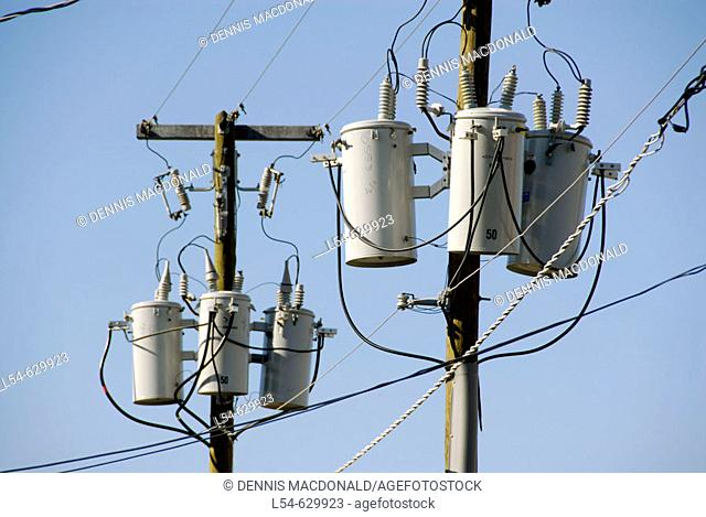 Electrical transformers located on poles in a residential neighborhoos