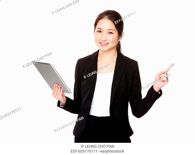 Businesswoman use of tablet and finger point up