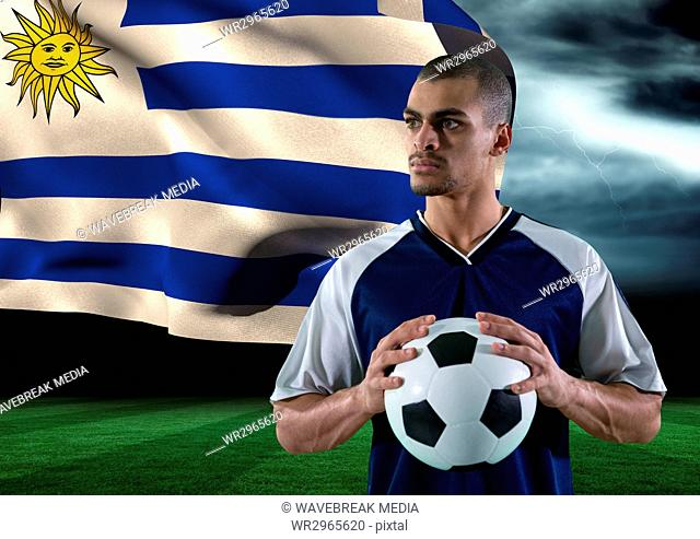 soccer player with ball on his hand in the field. storm. flag behind
