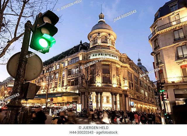 France, Paris, Printemps department store left bd Hausmann at dusk Galerie Lafayette