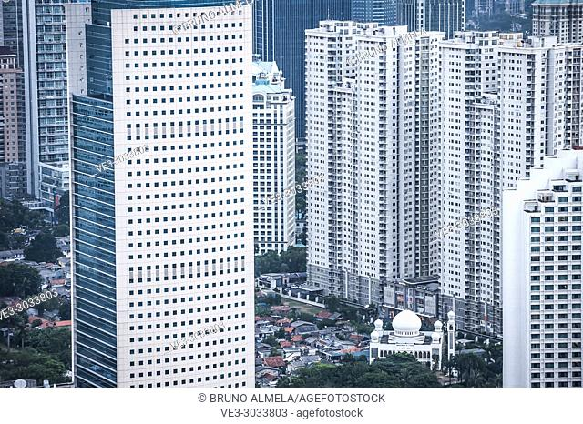 Al-I'Tisham Mosque surrounded by skyscrapers in Jakarta (Special Capital Region of Jakarta, Java, Indonesia)