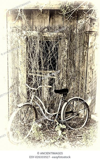 Vintage bicycle leans against an abandoned building