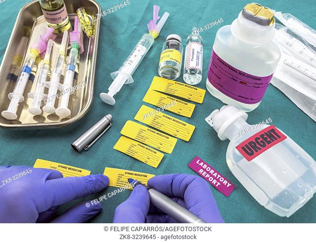 Nurse preparing hospital medication, Write sick data to medical assignment labels, conceptual image, horizontal composition