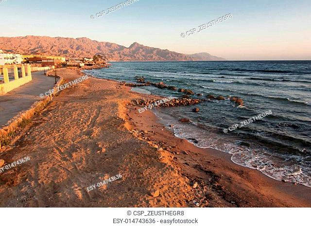 Dahab. restaurant and sun rise with mountains and sea in morning