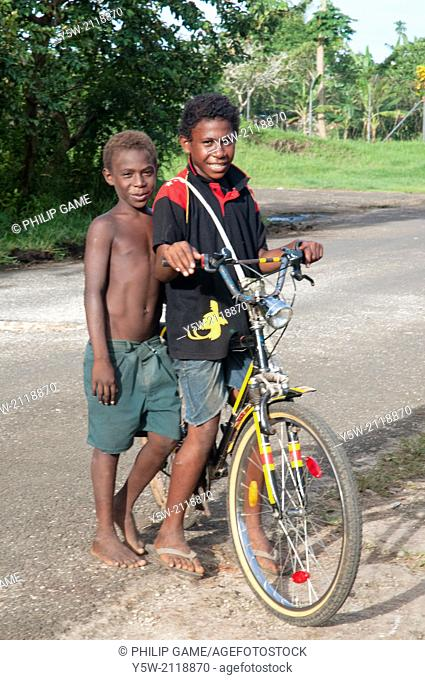 Boys with a bicycle, Kavieng