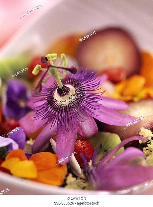 Mixed summer fruit salad with passionfruit flowers