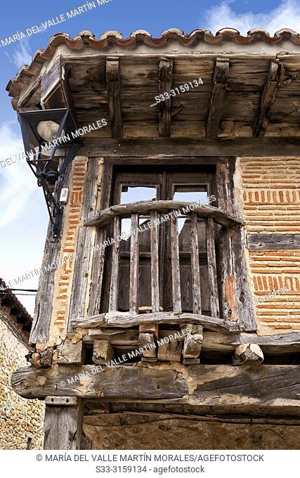 Old wooden balcony in Calatañazor. Soria. Castilla León. Spain. Europe