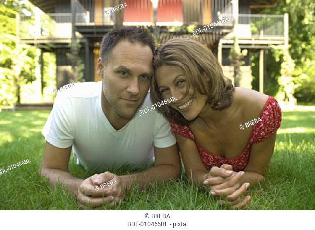 portrait of couple lying in the grass