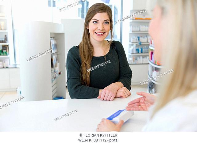 Female pharmacist advising female customer