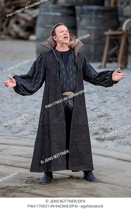 Wolfgang Lippert as ballad singer performs at the nature stage in Ralswiek on Ruegen island, Germany, 21 June 2017. Tis year's production titled 'Im Schatten...