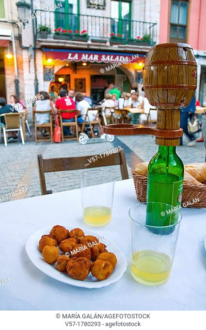 Two glasses of cider and croquettes serving. Ribadesella, Asturias province, Spain
