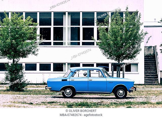 Germany, Mecklenburg-Vorpommern, Schwerin, Dreesch, prefabricated housing estate, car Moskwitsch Oldtimer