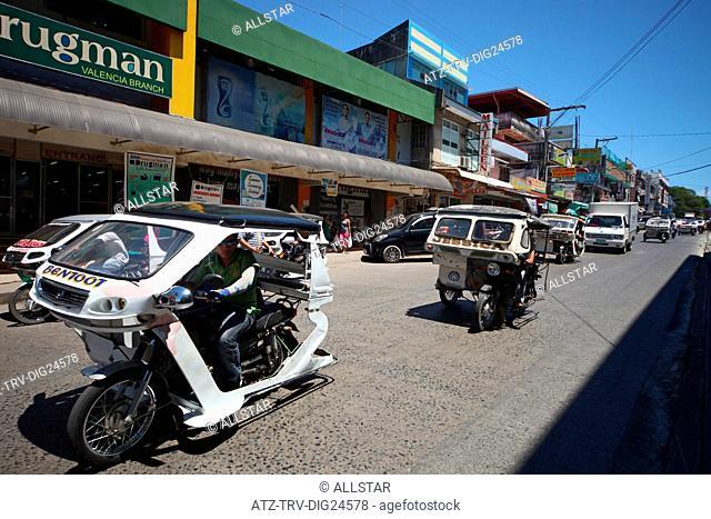 TRIKES ON VALENCIA STREET; PUERTO PRINCESA, PALAWAN, PHILIPPINES, ASIA; 22/04/2015