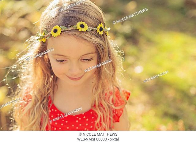 Portrait of smiling little girl wearing flower wreath