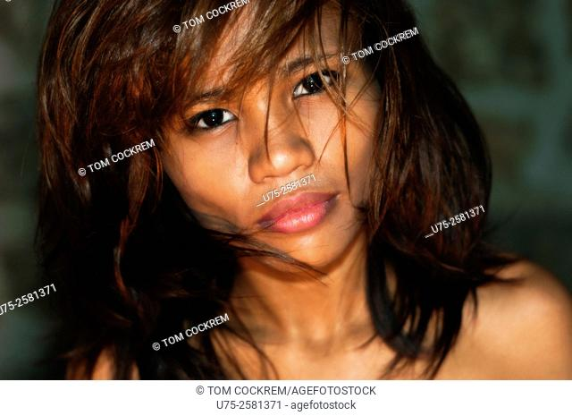 Young Asian woman exotic portrait, on location, Cebu, Philippines
