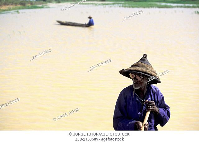 Fisherman in a pinasse boat near Djenne, Mopti, Mali