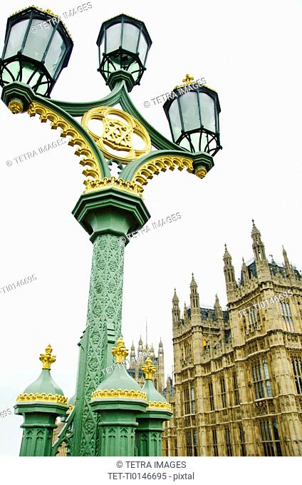 United Kingdom, London, Ornate street lamp with Houses of Parliament in background