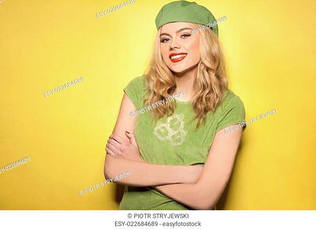 Confident beautiful woman in a green ensemble