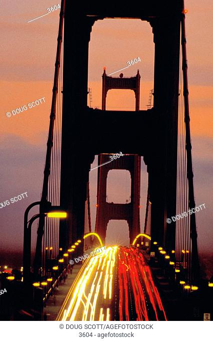 Heavy traffic on Golden Gate Bridge at dusk. San Francisco. California. USA