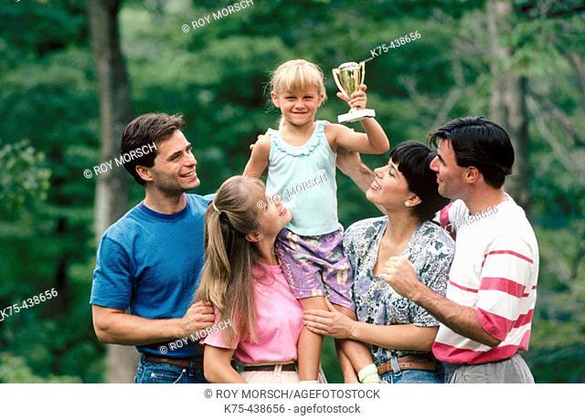 Family congratulating little girl