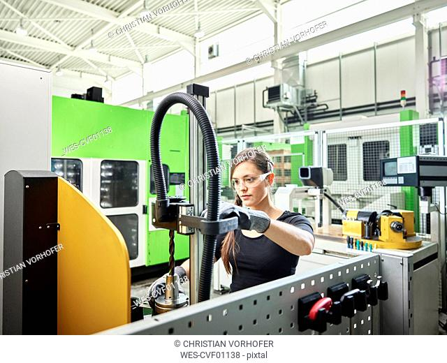 Young woman working on a machine