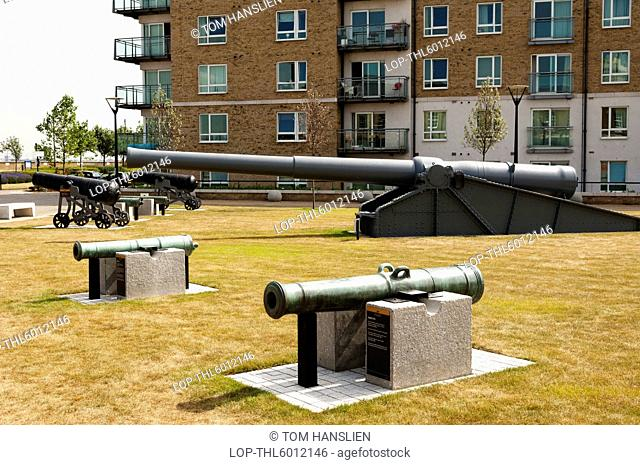 A display of cannons at Royal Arsenal Riverside with modern residential building in the background