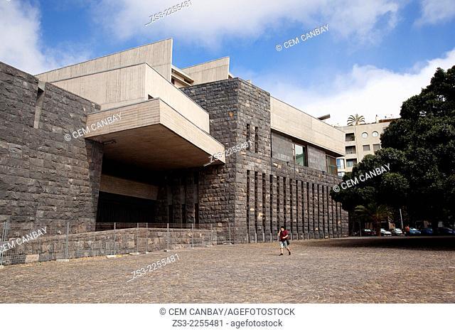 Man in front of a modern building in town center, Santa Cruz de Tenerife, Tenerife, Canary Islands, Spain, Europe