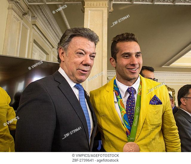 The President Juan Manuel Santos (L)and Carlos Alberto Ramirez Colombian male BMX rider(R) in the ceremony Where the colombian president have delivered the...
