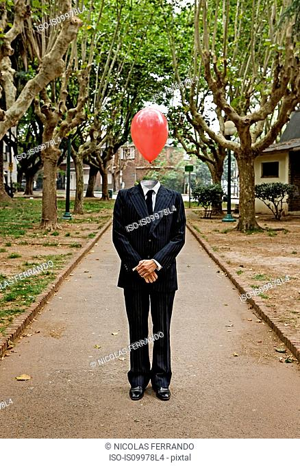 Businessman standing with a balloon for a head