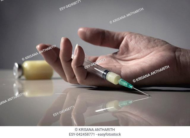 The man committing suicide by overdosing on medication. Close up of overdose pills and addict