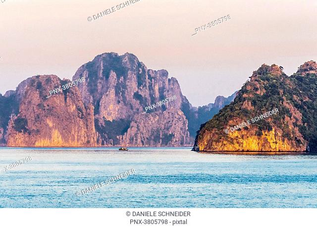 Vietnam, Ha Long Bay at sunset, (UNESCO World Heritage)