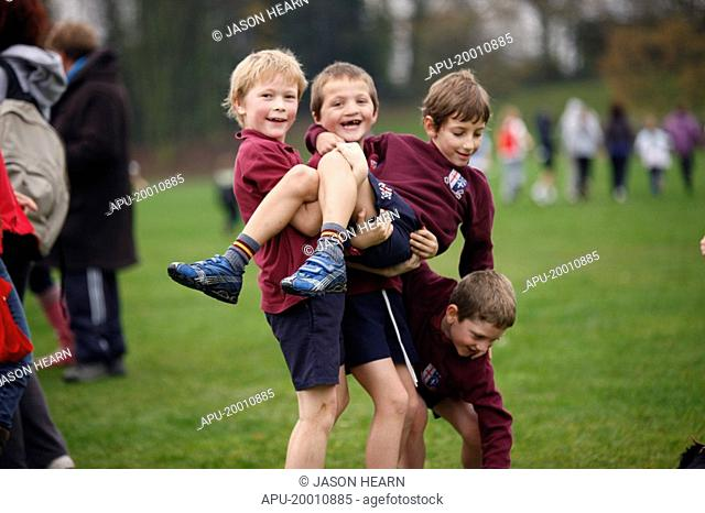 Boys playing in park during cross country event
