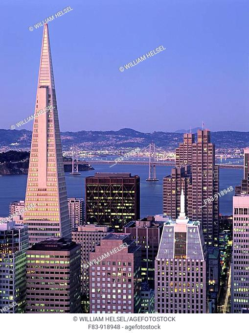 USA, California, San Francisco, financial district high-rise office buildings including Trans-America pyramid on left, Embarcadero Center on right