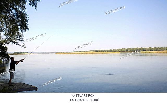 Young Man Fishing in the Zambezi River - Side View  Lower Zambezi National Park, Southern Province, Zambezi