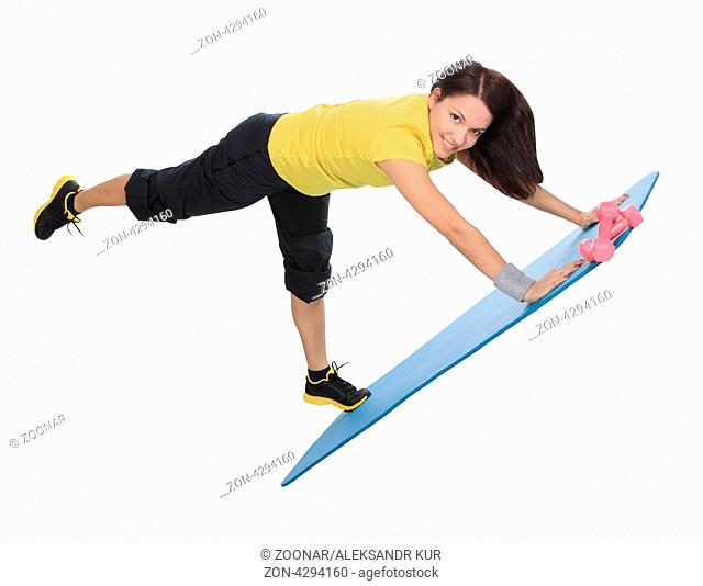 Attractive young female with fitness dumbbells does exercise