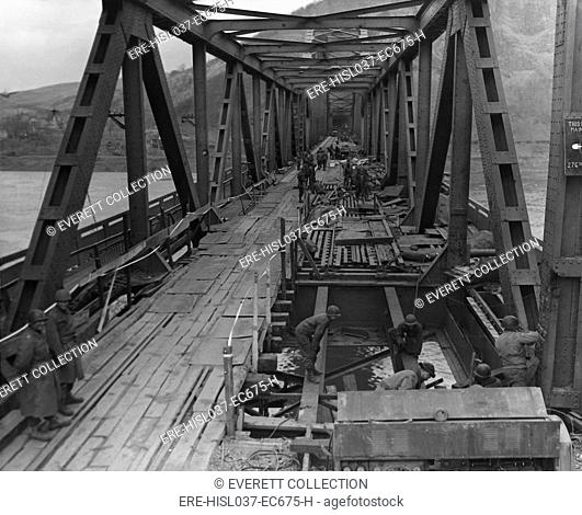 U.S. First Army at Remagen Bridge before four hours before it collapsed into the Rhine River. The sudden collapse killed eighteen U.S