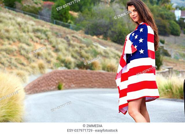 Woman wearing American Flag, walking on the street
