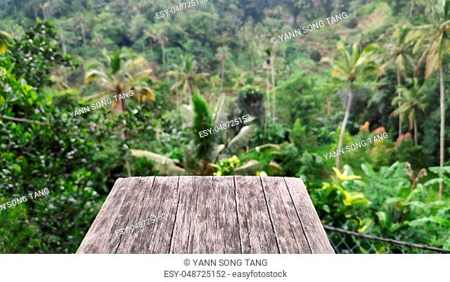 Wooden front with Balinese blurred jungle background