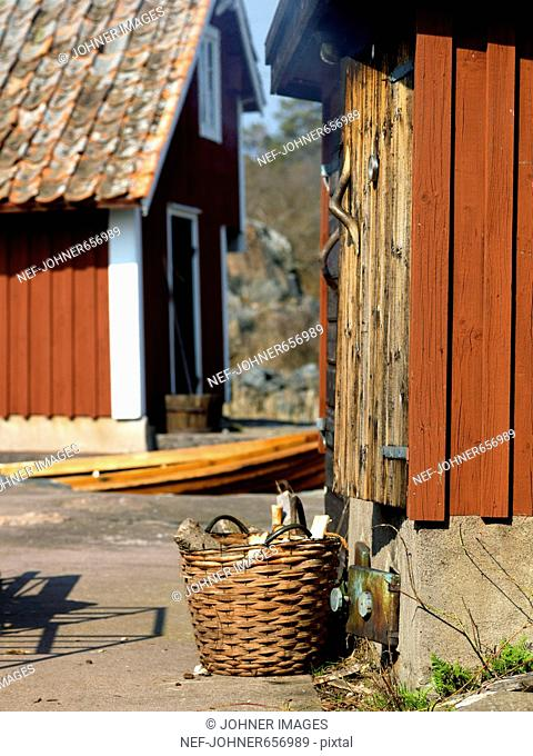 Firewood in front of a smokehouse, Sweden