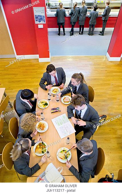 High school students eating lunch in cafeteria