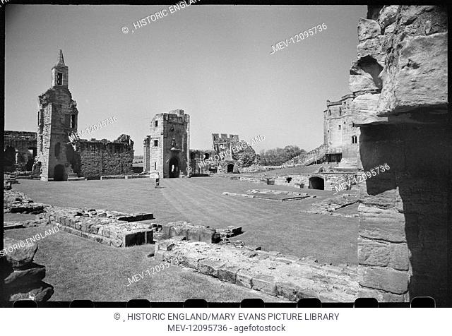 An interior view of Warkworth Castle, showing the west range and a partial view of the caslt donjon in the north, seen from the Outer Ward in the south of the...