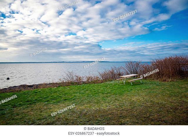 An empty bench on the beach