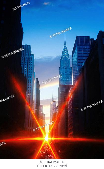 USA, New York, New York City, Chrysler Building and street at sunset
