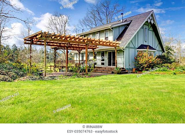 Designed rustic farmhouse with open front deck and attached wood pergola