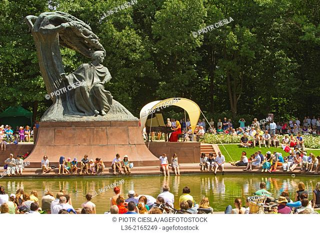 Lazienki Park. A open air weekly summer concert of Chopins music by the monument to Chopin