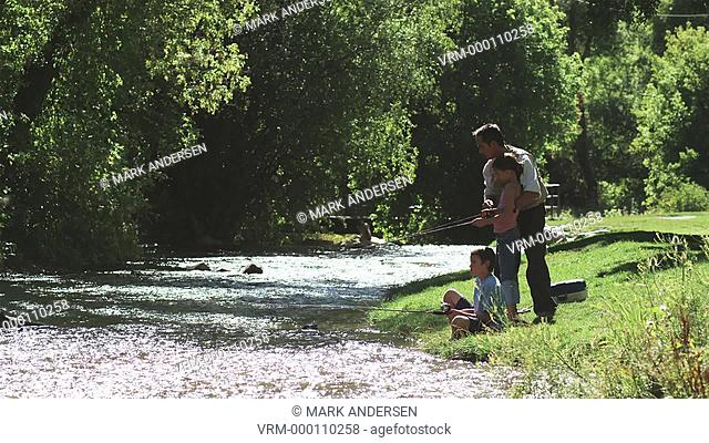 father and children fishing