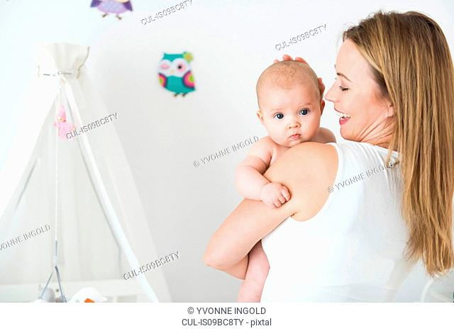 Mother and baby in nursery room